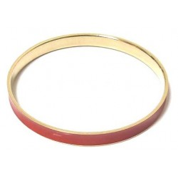 Women's fancy bracelet in gold metal trimmed with a red band