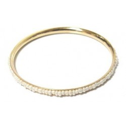Women's fancy bracelet in gold metal adorned with a band of oval white pearls