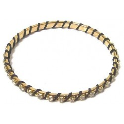 Women's fancy bracelet in golden metal adorned with crystalline stones and wrapped in...