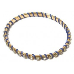 Women's fancy bracelet in gold metal adorned with crystalline stones and wrapped in...