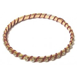 Women's fancy bracelet in gold metal adorned with crystalline stones and wrapped in red...
