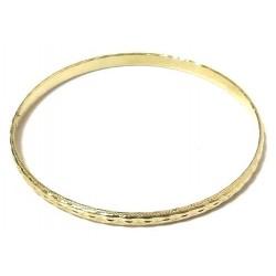 Women's fancy bracelet in golden metal adorned with carving