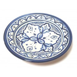 Decorative Moroccan plate in enamelled pottery painted in white and blue and decorated...