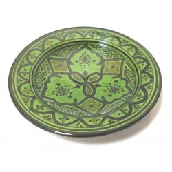 Decorative Moroccan plate in enamelled pottery painted in green and decorated with...