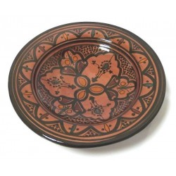 Decorative Moroccan plate in enamelled pottery painted in brick red and decorated with...