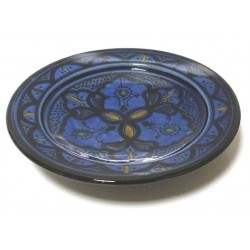 Decorative Moroccan plate in enamelled pottery painted in blue and decorated with patterns