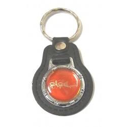 Keyring in the shape of a medallion bearing an inscription of the Basmalah (بسم الـله...