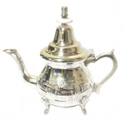 Small traditional Moroccan teapot in silver metal with pretty carvings