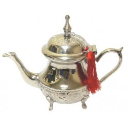Moroccan teapot of medium size nickel plated silver nicely chiseled and decorated with...