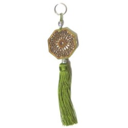 Heptagon-shaped wooden keyring / pendants carved with arabesques and decorated with...