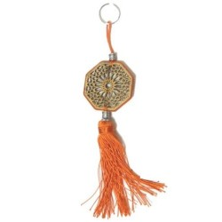 Keyring / pendants in heptagon-shaped wood carved with arabesques and decorated with...
