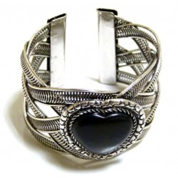 Adjustable cuff bracelet in chiseled silver metal adorned with black stone in the shape...