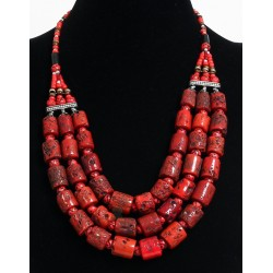 Ethnic Berber style artisanal necklace in coral imitation pieces and pearls arranged...