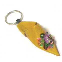 Traditional Moroccan babouche keychain in yellow leather with multicolored strass