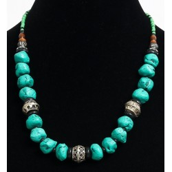 Ethnic artisanal necklace imitation deformed turquoise stones arranged with silver beads