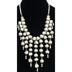 Ethnic necklace imitation white stones with several hanging rows arranged with chains...