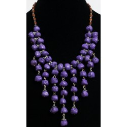 Ethnic necklace imitation mauve stones with several hanging rows arranged with chains...