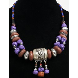 Magnificent ethnic artisanal necklace imitation brown and mauve stones, arranged with...