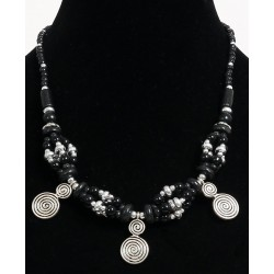 Ethnic artisanal necklace black pearls arranged with silver embellishments garnished...