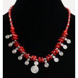 Ethnic artisanal necklace pieces imitation red coral arranged with red and silver...