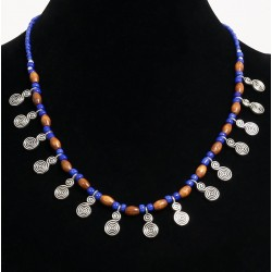 Ethnic artisanal necklace blue beads arranged with wooden tubes, embellished with small...