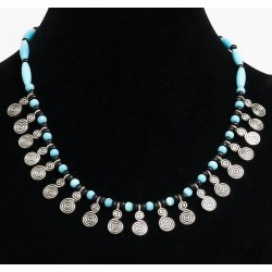 Ethnic artisanal necklace imitation turquoise and black pearls arranged behind by tube...