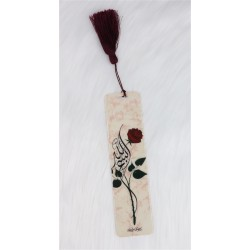 """Brand-page with basmala """"Bismilllah"""" calligraphed in a flower and pompon in brown sabra"""