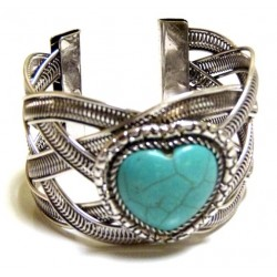 Adjustable cuff bracelet in chiseled silver metal adorned with turquoise blue stone in...