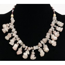 Ethnic artisanal necklace imitation marbled stones quartz arrangement and embellished...