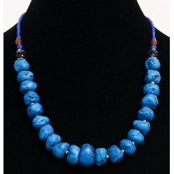 Ethnic artisanal necklace imitation misshapen blue stones separated from small metal...