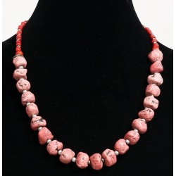 Ethnic handmade necklace imitation coral stones separated from metal beads and composed...