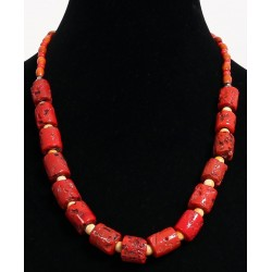 Ethnic artisanal necklace imitation burgundy red coral arranged with yellow, red and...