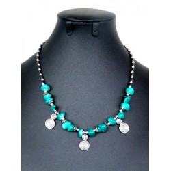 Moroccan artisanal necklace with turquoise stones, embellished with small swirl charms...