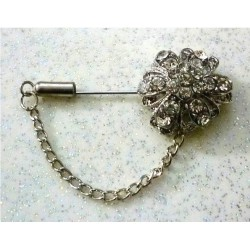 Flower-shaped silver hijab brooch with small stones