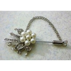 Flower-shaped silver hijab brooch with pearls in the middle