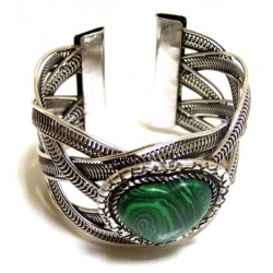Adjustable cuff bracelet in chiseled silver metal adorned with green stone in the shape...