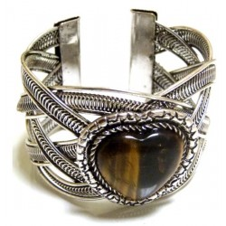 Adjustable cuff bracelet in chiseled silver metal adorned with brown stone in the shape...