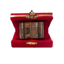 Decorative red velvet box with metal plate containing Islamic inscriptions