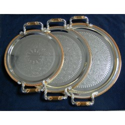 Set of three assorted round metal trays in different size