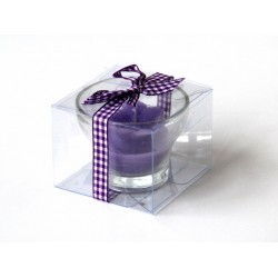 Scented candle in the form of a flower in mauve color with decorative ribbon