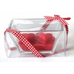 Double scented candle in its box with a red gift ribbon