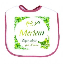 "Bib personalized with the baby's first name: ""Finally released after 9 months ...""."