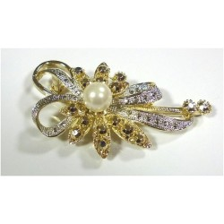 Golden and silver brooch in the form of a flower with large white pearl and rhinestones