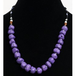 Ethnic artisanal necklace imitation deformed mauve balls, separated by metal beads with...