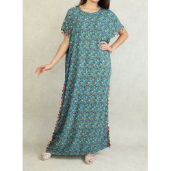 Floral summer dress with multicolored pompoms on an Azure blue background (Gandoura...