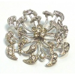 Silver metallic brooch in the form of an open flower with white diamonds