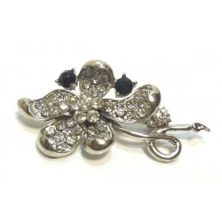 Metal brooch in the shape of a silver flower with black and white pearls