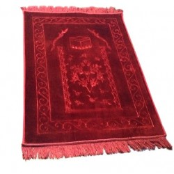 Large thick luxury prayer rug in burgundy color with pattern indicating the direction...